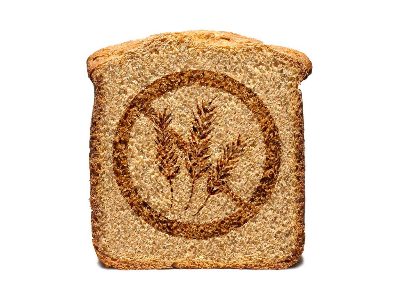 fetta di pane con disegnato il simbolo del divieto e le spighe di grano